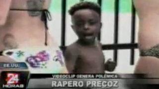 Polémica por video de niño cantando al lado de mujeres semidesnudas