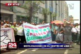 Gremios transportistas marchan exigiendo que les anulen fotopapeletas