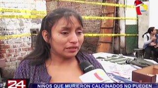 Madre de niños muertos en incendio recolecta dinero para sepultarlos