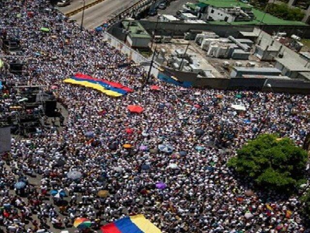 Miles de venezolanos marchan en defensa de líderes encarcelados