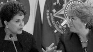 Popularidad de presidentas Bachelet y Rousseff en caída libre