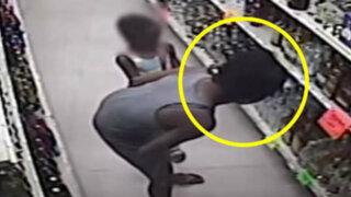 VIDEO: mujer enseña a su pequeña hija a robar alcohol de una licorería
