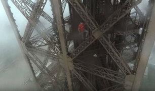 Francia: jóvenes rusos burlan seguridad y escalan Torre Eiffel