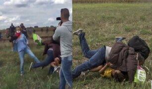 Hungría: acusan de vandalismo a periodista que agredió a refugiados
