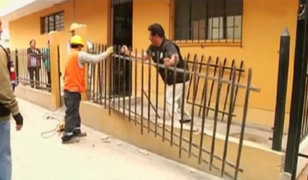 Los Olivos: retiran rejas que invadían vía pública
