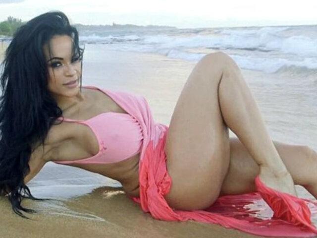 YouTube: Una sexy sesión de fotos en la playa se termina de la forma más inesperada [VIDEO]