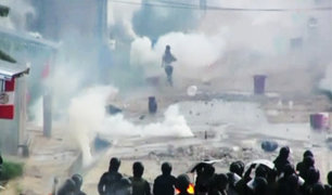 Iquitos: Policía logra desalojar a invasores de terreno tras feroz batalla campal