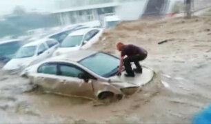 Intensas lluvias provocan desbordes de ríos e inundaciones en España y China