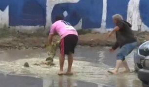 VES: calles inundadas por lloviznas genera problemas a transeúntes