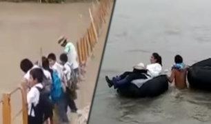 Piura: escolares cruzan por estructura de puente colapsado para asistir a clases