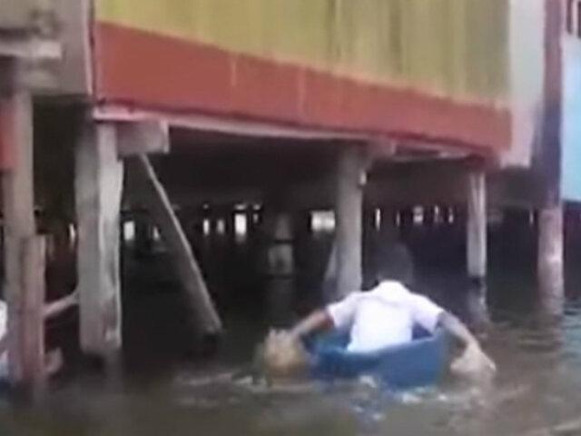 Iquitos: escolares utilizan bateas para cruzar río y llegar a su colegio