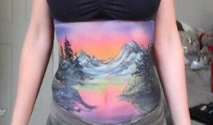 USA: artista usa su estomago como lienzo para sus pinturas