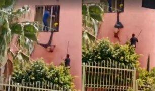 Ladrón queda colgado al intentar huir y lo golpean como piñata
