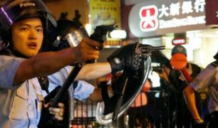 Hong Kong: policías disparan por primera vez en protestas