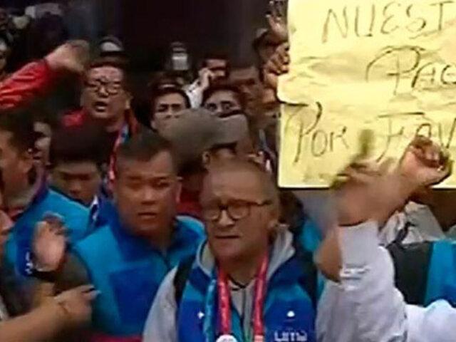Choferes de Panamericanos 2019 protestan solicitando les cancelen sus sueldos
