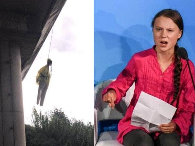 Muñeco con el rostro de la activista Greta Thunberg aparece colgado en puente de Roma