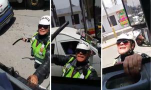 Mujer policía se trepa a la cabina de un camión para increpar a conductor