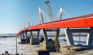 Inauguran puente de carretera que une Rusia y China