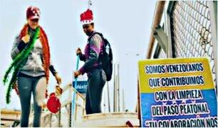 Migrantes venezolanos limpian y adornan puentes de Lima por Navidad