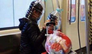China: improvisan mascarillas con toda clase de plásticos para protegerse del coronavirus