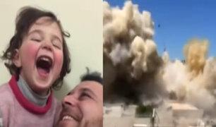 Siria: padre conmueve al mundo al inventar juego para que su hija ría cada que suena una bomba