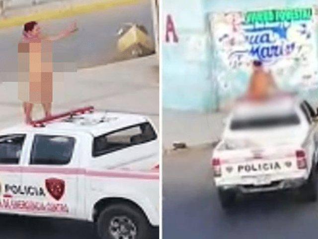 Mujer desnuda sube al techo de patrullero y arma escándalo en plena cuarentena