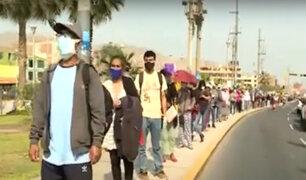 Ventanilla: decenas de personas hicieron largas colas para cobrar bono