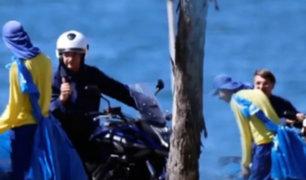 Jair Bolsonaro es visto paseando en moto y sin mascarilla