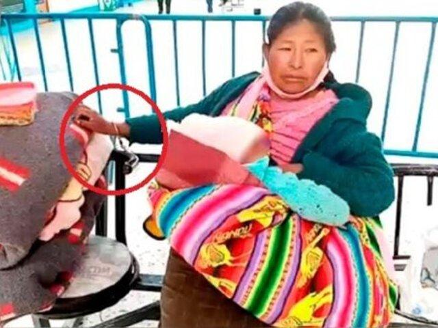 Juliaca: mujer es enmarrocada con su bebé en brazos a una silla de Terminal Terrestre