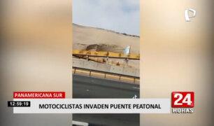 Motociclistas utilizan puente peatonal para cruzar la Panamericana Sur