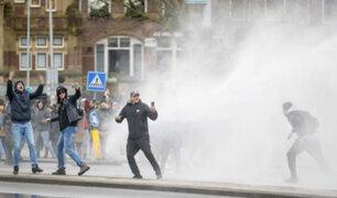 Holanda: enfrentamientos, incendios y saqueos durante protestas contra el toque de queda