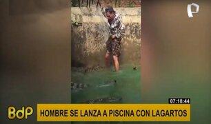Hombre se mete a estanque lleno de lagartos para demostrar su valentía