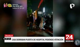 Trujillo: familiares de paciente COVID-19 intentan derribar puerta de hospital