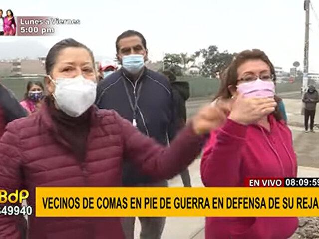 Comas: vecinos enfrentados con un grifo por defender reja de seguridad