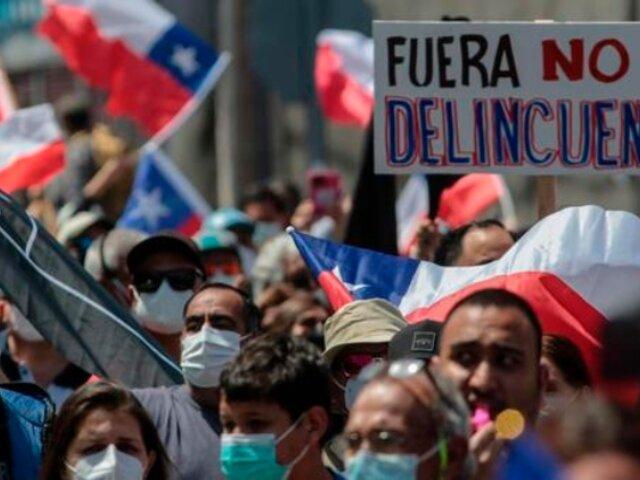 """ONU expresa """"preocupación por violencia y xenofobia"""" contra migrantes en Chile"""